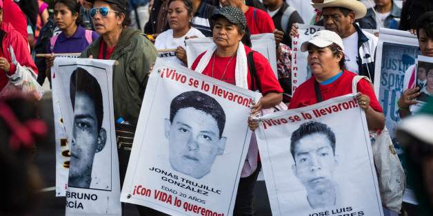 MEXICO CITY, MEXICO - JANUARY 26: Relatives of the missing students, attend a protest for the 43 missing students, in Mexico City, Mexico on January 26, 2015 after four months of their disappearance in Iguala, Guerrero.  (Photo by Daniel Cardenas/Anadolu Agency/Getty Images)