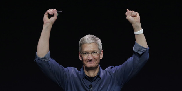 Apple CEO Tim Cook introduces Apple Watch , which he is wearing on his wrist, on Tuesday, Sept. 9, 2014, in Cupertino, Calif.  (AP Photo/Marcio Jose Sanchez)