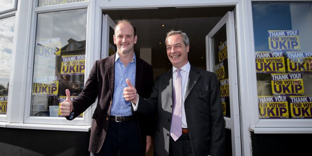 Newly-elected UK Independence Party (UKIP) MP Douglas Carswell (L) and party leader Nigel Farage pose for pictures at their local party office in Clacton-on-Sea, in eastern England, on October 10, 2014. Britain's anti-EU UK Independence Party won its first seat in the House of Commons Friday, sending jitters through Prime Minister David Cameron's Conservatives seven months before what is likely to be a tight general election.  AFP PHOTO / LEON NEAL        (Photo credit should read LEON NEAL/AFP/
