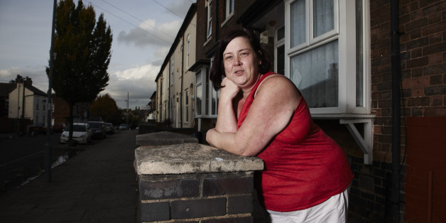 "In this photo provided by Channel 4 on Tuesday, Jan. 21, 2013, 'White Dee' featured in the show Benefits Street,  poses for a promotional still. The stars of Britain's most talked-about television show have a dubious claim to fame: They don't work. A shoplifter running away from police, a recovering drug addict and a ragtag band of jobless people are the unlikely stars of ""Benefits Street,"" a hit documentary-style program about welfare receipients that has drawn millions of v"