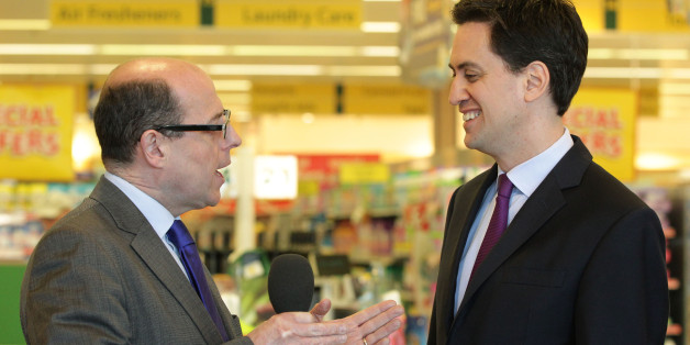Labour leader Ed Miliband speaks with BBC News political editor Nick Robinson during a visit to Morrisons supermarket in Camden, north London.