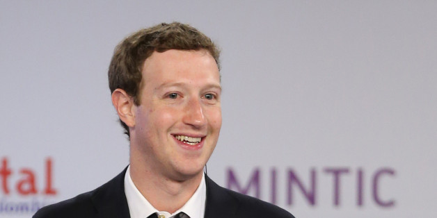 Facebook founder and CEO Mark Zuckerberg smiles during an event to launch in Colombia an app providing free basic Internet service via cellphone connections, in Bogota, Colombia, Wednesday, Jan. 14, 2015. (AP Photo/Fernando Vergara)