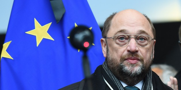 European Parliament President Martin Schultz wears a badge reading 'Je suis Charlie' (I am Charlie) as European Parliament members hold a minute of silence at the European Parliament in Brussels on January 8, 2015, for the victims of the January 7 attack against French satirical weekly newspaper Charlie Hebdo which left 12 people dead. A stunned and outraged France began a national day of mourning on January 8, as security forces desperately hunted two brothers suspected of gunning down 12 people in an Islamist assault on a satirical weekly, the country's bloodiest attack in half a century. AFP PHOTO / EMMANUEL DUNAND        (Photo credit should read EMMANUEL DUNAND/AFP/Getty Images)