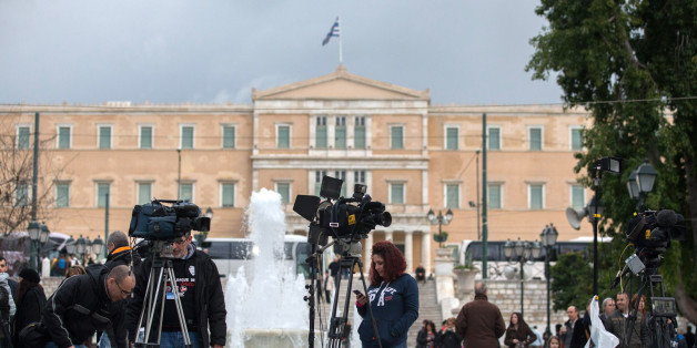 ATHENS, GREECE - JANUARY 25:  Media crew set up in front of the Greek Parliament building on January 25, 2015 in Athens, Greece. According to the latest opinion polls, the left-wing Syriza party are poised to defeat Prime Minister Antonis Samaras' conservative New Democracy party in the election, which will take place today. European leaders fear that Greece could abandon the Euro, write off some of its national debt and put an end to the country's austerity by renegotiating the terms of its bailout if the radical Syriza party comes to power. Greece's potential withdrawal from the eurozone has become known as the 'Grexit.'  (Photo by Matt Cardy/Getty Images)