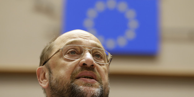 European Parliament President Martin Schulz addresses the members of the European Parliament to commemorate the 25th anniversary of the fall of the wall in Berlin, at the hemicycle of the European Parliament building in Brussels, Wednesday, Nov. 12, 2014. (AP Photo/Yves Logghe)
