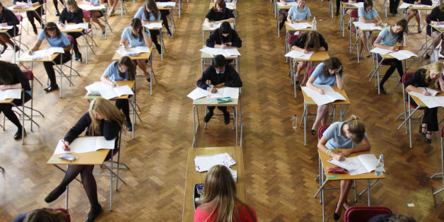 File photo dated 11/06/08 of pupils during a GCSE exam as official figures published by the Department for Education (DfE) show that fewer teenagers scored at least five C grades in their GCSEs, including English and maths, this year amid major changes to the exams and school league tables.