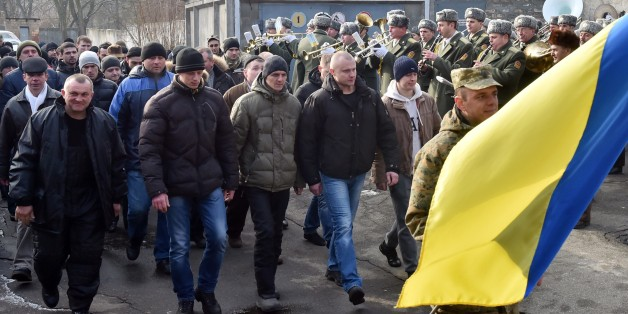 Column of reservists, called up to participate in the fighting in the east of Ukraine, march during a ceremony held at a one of the recruiting offices in Kiev on January 29, 2015. Ukrainian President Petro Poroshenko on January 29 called for urgent truce talks with pro-Russian rebels to end a bloody surge in fighting. Poroshenko said the new meeting in the Belarussian capital should lead to 'an immediate ceasefire and the withdrawal of heavy weapons from the line of contact.' AFP PHOTO/ SERGEI S