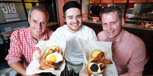 Television chef Phil Vickery (left) presents the 2015 Best Breakfast Award for the UK's Most Innovative Breakfast to Atholl Milton CEO of Bunnychow (right) and Chef Finn Baire (centre), for the Full English Bunny - an individually baked brioche loaf which is hollowed out and filled with sausage, lean bacon, tomatoes, mushrooms, spicy baked beans, black pudding and topped with an egg, at Bunnychow in Wardour Street in London.