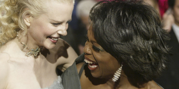 Nicole Kidman, left, and Oprah Winfrey laugh as they arrive at the Vanity Fair post-Oscar party, Sunday, Feb. 29, 2004, in the West Hollywood section of Los Angeles. (AP Photo/Chris Weeks)