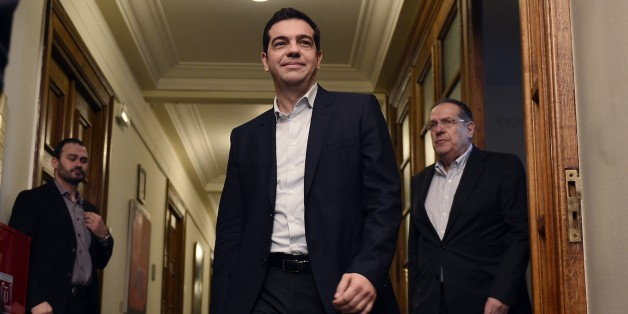 Newly elected Greek Prime Minister Alexis Tsipras (C) arrives on January 28, 2015 for his first cabinet meeting at the Greek Parliament in Athens.  Greece's new radical left-led government prepared to meet on January 28 for the first time to hammer out a strategy for renegotiating the country's giant bailout, after storming to power on a promise to reject years of harsh austerity policies.                       AFP PHOTO / LOUISA GOULIAMAKI        (Photo credit should read LOUISA GOULIAMAKI/AFP/