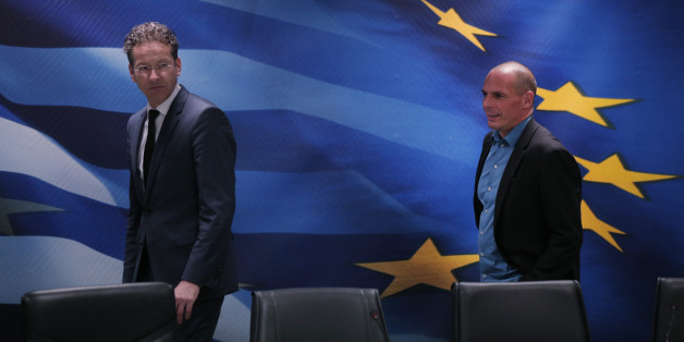 Dutch Finance Minister and Eurogroup President Jeroen Dijsselbloem, left, followed by Greece's Finance Minister Yanis Varoufakis, right, arrive for a joint news conference following their meeting at the Finance Ministry in Athens, Friday, Jan. 30, 2015. Dijsselbloem who chairs eurozone finance meetings says there is no decision so far on what to do after Greece's current bailout program runs out at the end of next month. (AP Photo/Lefteris Pitarakis)