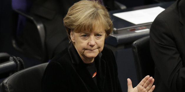 German Chancellor Angela Merkel applauds during a ceremony commemorating the 70th anniversary of the liberation of the Nazi Auschwitz death camp in the German parliament Bundestag in Berlin, Germany, Tuesday, Jan.  27, 2015. (AP Photo/Michael Sohn)