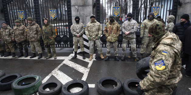 KIEV, UKRAINE - JANUARY 30: Volunteer soldiers' battalion 'Aydar' blocking the roadway in front of the Ministry of Defense, during a protest in Kiev, Ukraine on January 30, 2015. Soldiers protest against the disbandment of their battalion. (Photo by Vladimir Shtanko/Anadolu Agency/Getty Images)