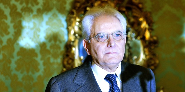 Newly elected President of Italy, Sicilian judge Sergio Mattarella looks on as he arrives at the Constitutional Council in Rome, on January 31, 2015. Renzi's backing for Mattarella has been interpreted as the end of a temporary alliance the premier forged with disgraced former prime minister Silvio Berlusconi to help drive labour market and electoral reforms through parliament. Mattarella is seen as an 'anti-Berlusconi' figure, having severed his ties with the centre right in Italian politics pa
