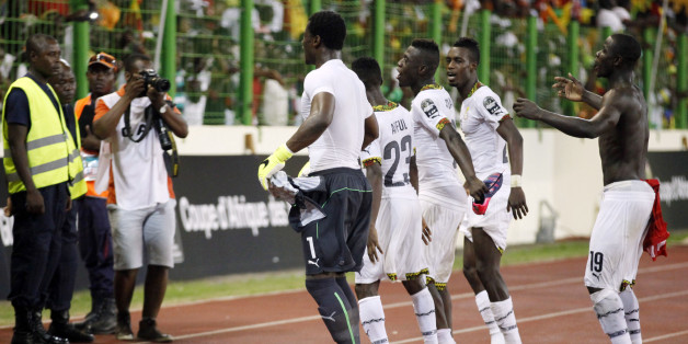 Ghana soccer players celebrate after their African Cup of Nations quarter final soccer match with Guinea at the Estadio De Malabo, Equatorial Guinea, Sunday, Feb. 1, 2015. (AP Photo/Sunday Alamba)