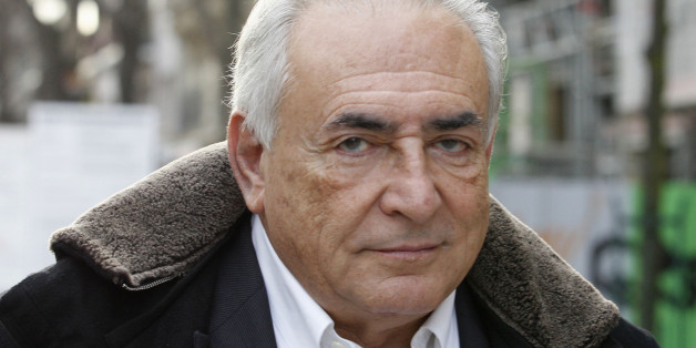 FILE - In this Dec. 11, 2012 file photo, former International Monetary Fund chief Dominique Strauss-Kahn leaves his apartment building in Paris. French judges decided Wednesday, Dec.19, 2012 not to drop aggravated pimping charges against Strauss-Kahn. His lawyer says he will appeal. (AP Photo/Jacques Brinon, File)