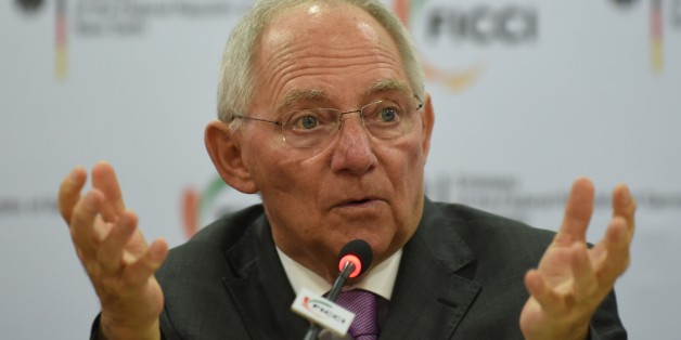 German Finance Minister Wolfgang Schauble delivers his address during a function entitled 'Europe and India in the face of Globalisation' organised by the Federation of Indian Chambers of Commerce and Industry (FICCI) in New Delhi on January 20, 2015. Germany's finance minister was looking to reassure India that the eurozone is not about to lurch into a fresh crisis ahead of talks with his counterpart in New Delhi. AFP PHOTO / SAJJAD HUSSAIN        (Photo credit should read SAJJAD HUSSAIN/AFP/Ge