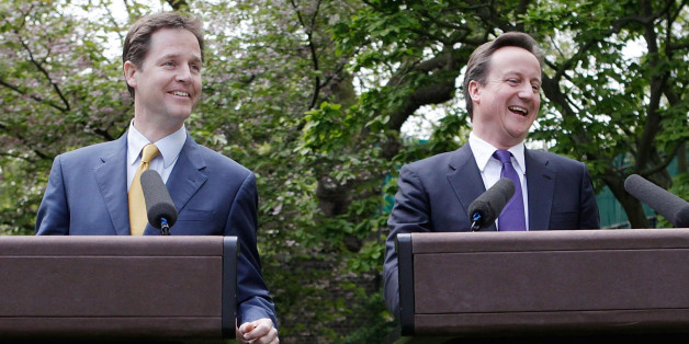 Prime Minister David Cameron (right) and Deputy Prime Minister Nick Clegg hold their first joint press conference in the Downing Street garden in central London.