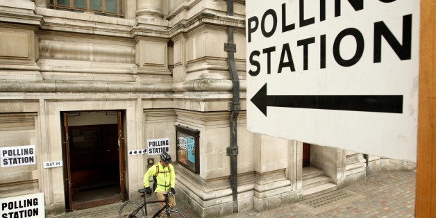 A voter leaves the polling station at the Methodist Central Hall in Westminster, central London, shortly after voting started across the UK in the General Election.