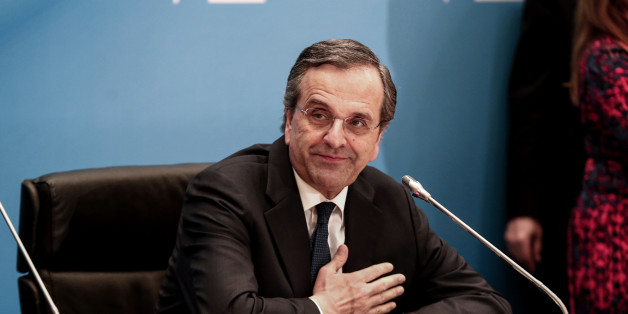 Antonis Samaras, Greece's prime minister, acknowledges his supporters as he makes statements at Zappeion hall in Athens, Greece, on Sunday, Jan. 25, 2015. Greek voters go to the polls today in a general election that will decide whether Europe's most-indebted country sticks to the economic-overhaul program set out by its troika of official creditors or tries to chart its own course. Photographer: Yorgos Karahalis/Bloomberg via Getty Images