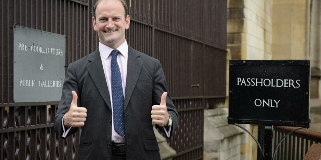 Newly elected United Kingdom Independence Party (UKIP) MP Douglas Carswell poses for pictures as he arrives at the Houses of Parliament in central London, on October 13, 2014. Britain's anti-EU UK Independence Party won its first seat in the House of Commons Friday October 10, 2014, sending jitters through Prime Minister David Cameron's Conservatives seven months before what is likely to be a tight general election. AFP PHOTO/Leon Neal        (Photo credit should read LEON NEAL/AFP/Getty Images)