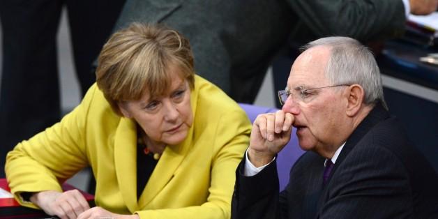 German Chancellor Angela Merkel (L) and German Finance Minister Wolfgang Schaeuble (R) chat during a session of the Lower house of parliament Bundestag on November 28, 2014 at the Reichstag building in Berlin before a vote to approve the budget blueprint for 2015. AFP PHOTO / JOHN MACDOUGALL        (Photo credit should read JOHN MACDOUGALL/AFP/Getty Images)