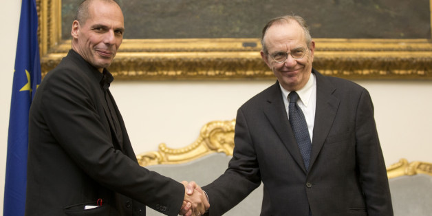 Greece's finance minister, Yanis Varoufakis, left, shakes hands with his Italian counterpart Pier Carlo Padoan during a photo opportunity prior to the start of their meeting in Rome, Tuesday, Feb. 3, 2015. Hopes for a deal between Greece and its European creditors got a boost after the country's new government backed away from demands to write off a chunk of its bailout loans, a prospect that had horrified creditors and investors. Tsipras and Varoufakis arrived in Italy on Tuesday, for talks wit