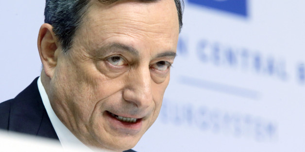 In this Thursday, Jan. 22, 2015 photo, President of European Central Bank Mario Draghi speaks during a news conference in Frankfurt, Germany, following a meeting of the ECB governing council. Draghi delivered on a pledge to do whatever it takes to pull Europe out of a deep and prolonged slump. The central bank will buy 1.1 trillion euros ($1.3 trillion) worth of government and corporate bonds through September 2016 _ longer if necessary _ to shrink the euro's value, boost exports and encourage borrowing, spending and hiring. (AP Photo/Michael Probst)