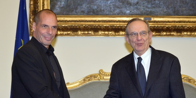 Greek Minister of Finance Yanis Varoufakis (L) shakes hands with his Italian counterpart Pier Carlo Padoan during their meeting on February 3, 2015 in Rome. Greece sought to add Italy to its supporters in a fight to secure easier terms on the country's massive debt after unveiling new proposals to end a stand-off with international lenders. Greek Finance Minister Yanis Varoufakis told international financiers in London yesterday that the leftist-dominated government in Athens would be making proposals for 'a menu of debt swaps' that would avoid the need for any of the country's 315-billion-euro mountain of foreign debt to be written off.    AFP PHOTO / TIZIANA FABI        (Photo credit should read TIZIANA FABI/AFP/Getty Images)