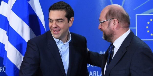 European Parliament President Martin Schulz (R) greets Greek Prime Minister Alexis Tsipras on February 4, 2015 at the European Parliament in Brussels. The euro held its gains on February 4 after a surge driven by growing optimism that Greece will hammer out a debt deal and avoid a possible default.  AFP PHOTO / EMMANUEL DUNAND        (Photo credit should read EMMANUEL DUNAND/AFP/Getty Images)