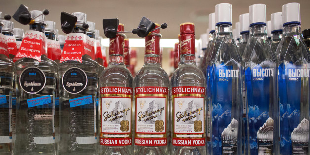 Bottles of Stolichnaya Russian vodka sit on a shelf inside a Dixy supermarket operated by OAO Dixy Group in Moscow, Russia, on Tuesday, April 8, 2014. Suppliers suffering from ruble depreciation this quarter are urging retailers to increase prices. Photographer: Andrey Rudakov/Bloomberg via Getty Images