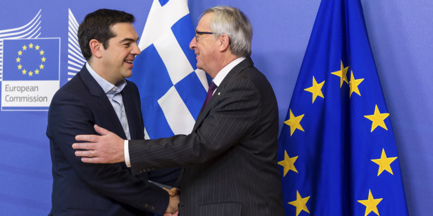 European Commission President Jean-Claude Juncker, right, welcomes Greece's Prime Minister Alexis Tsipras upon his arrival at the European Commission headquarters in Brussels Wednesday, Feb. 4, 2015. Tsiparis is on a one day trip to Brussels to meet with EU leaders. (AP Photo/Geert Vanden Wijngaert)