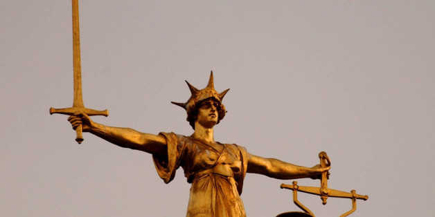 The Scales of Justice on top of the Old Bailey in central London, as the jury in the Soham murder case enters the third night of deliberation. Lord Justice Moses has sent the jury to reach verdict in the case agianst Ian Huntley and Maxine Carr, who face charges relating to the unlawful deaths of school girls Holly Wells and Jessica Chapman.
