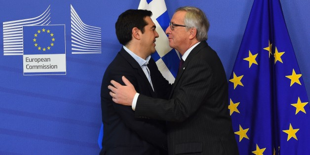 European Commission President Jean-Claude Juncker (R) greets Greek Prime Minister Alexis Tsipras at the European Commission headquarters in Brussels on February 4, 2015. Greek Prime Minister Alexis Tsipras made his first visit to Brussels since coming to power, promising to renegotiate his country's international bailout. AFP PHOTO / EMMANUEL DUNAND        (Photo credit should read EMMANUEL DUNAND/AFP/Getty Images)