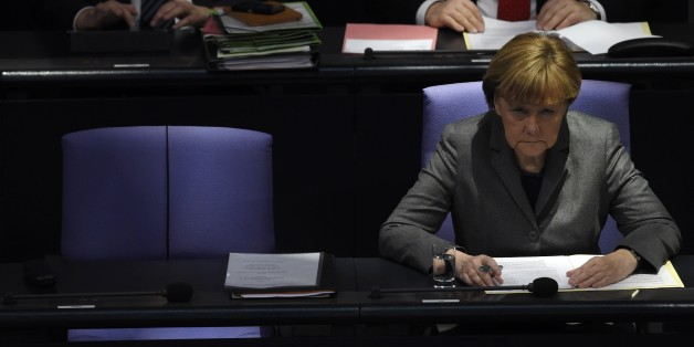 German Chancellor Angela Merkel attends a session of the Bundestag (German lower house of parliament) in Berlin January 29, 2015.  AFP PHOTO / TOBIAS SCHWARZ        (Photo credit should read TOBIAS SCHWARZ/AFP/Getty Images)