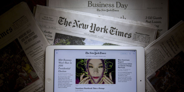 An Apple Inc. iPad displays the New York Times application (app) while sitting on New York Times newspapers in this arranged photograph in Washington, D.C., U.S., on Friday, Jan. 30, 2015. The New York Times Co. is expected to release fourth-quarter earnings on Feb. 3. Photographer: Andrew Harrer/Bloomberg via Getty Images