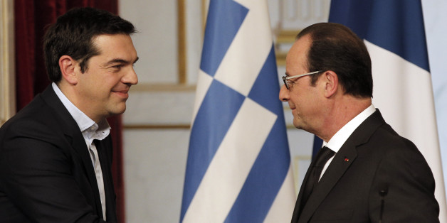 Greece's Prime Minister Alexis Tsipras, left, and French President Francois Hollande, shake hands after a press conference at the Elysee Palace, in Paris, France, Wednesday, Feb. 4, 2015.  In a short trip to Brussels before heading to France, Tsipras was welcomed at the European Commission, one of the three main institutions overseeing Greece's finances, by President Jean-Claude Juncker. (AP Photo/Christophe Ena)
