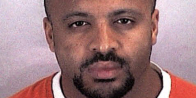 "FILE - In this undated file photo provided by the Sherburne County Sheriff Office, Zacarias Moussaoui is shown. Moussaoui, known as the ""20th hijacker"" in the 9/11 terror attacks is asking a South Florida federal judge for a transfer to the military prison at Guantanamo Bay, Cuba. The request is part of a rambling, handwritten letter filed Wednesday, Dec. 10, 2014,  in Miami federal court. He is serving a life prison sentence after pleading guilty in 2005 to conspiring with the Sept. 11 hijackers to kill Americans. Moussaoui has been writing letters to courts around the country from his prison cell in Florence, Colorado, claiming inside knowledge about al-Qaida and the Sept. 11, 2001, plot. The letter filed in Miami repeats some of those claims. (AP Photo/Sherburne County, Minn., Sheriff's Office, File)"