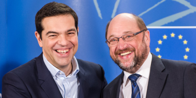 European Parliament President Martin Schulz, right, welcomes Greece's Prime Minister Alexis Tsipras upon his arrival at the European Parliament in Brussels on Wednesday, Feb. 4, 2015. Tsipras is on a one day trip to Brussels to meet with EU leaders.(AP Photo/Geert Vanden Wijngaert)