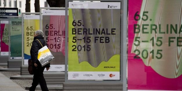 A woman walks by bildboards featuring ad for the 65th edition of the Berlinale Film Festival on the Potsdamer Platz, in Berlin January 23, 2015. This year's edition takes place from 05 to 15 February, 2015. AFP PHOTO / JOHN MACDOUGALL        (Photo credit should read JOHN MACDOUGALL/AFP/Getty Images)