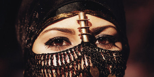 """I didn't take this shot which was used in a local Vodafone campaign a few years back. This Arabian beauty from Sinai, Egypt is wearing a traditional bedouin head dress (that is covered with golden coins) to show her exotic eyes that are covered by an ancient dark makeup called """"Kohl"""" originally used by the early Arabs and in ancient Egypt."""