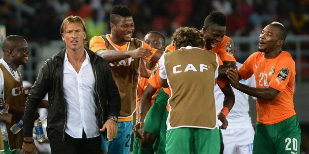 Ivory Coast's players and coach Herve Renard celebrate after scoring a third goal during the 2015 African Cup of Nations semi-final football match between Democratic Republic of the Congo and Ivory Coast in Bata on February 4, 2015.  AFP PHOTO / KHALED DESOUKI        (Photo credit should read KHALED DESOUKI/AFP/Getty Images)
