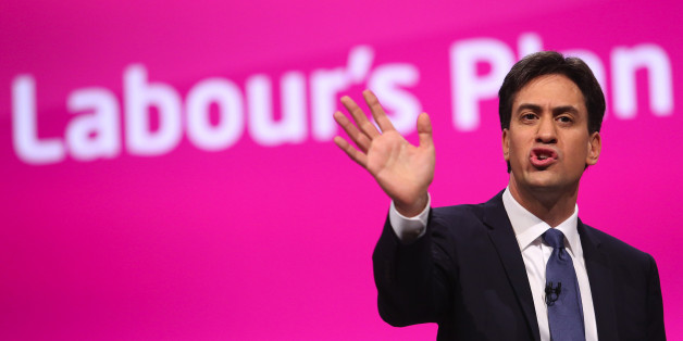 Ed Miliband, leader of the U.K. opposition Labour Party, gestures as he addresses delegates at the party's annual conference in Manchester, U.K., on Tuesday, Sept. 23, 2014. Miliband will today offer voters a 10-year vision of the U.K. if his opposition Labour Party wins power in next year's general election, focusing on bread-and-butter issues such as housing, jobs and pay. Photographer: Chris Ratcliffe/Bloomberg via Getty Images