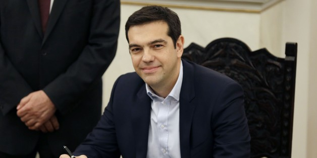 Greece's Prime Minister Alexis Tsipras poses for the photographers after taking a secular oath at the Presidential Palace in Athens, Monday, Jan. 26, 2015. Radical left leader Alexis Tsipras has been sworn in as Greece's new prime minister, becoming the youngest man to hold the post in 150 years. The 40-year-old broke with tradition and took a secular oath rather than the Greek Orthodox religious ceremony with which prime ministers are usually sworn in. (AP Photo/Thanassis Stavrakis)