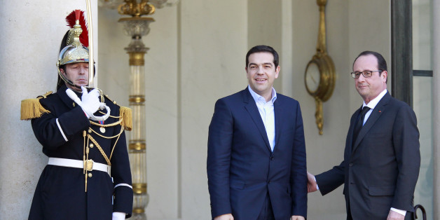 French President Francois Hollande, right, poses with Greek prime minister Alexis Tsipras prior to their meeting at the Elysee Palace in Paris, Wednesday Feb. 4, 2015. Riding a wave of popular discontent with an EU austerity drive led by economic powerhouse Germany, Tsipras has so far shunned the so-called troika — the European Commission, European Central Bank and the International Monetary Fund. (AP Photo/Remy de la Mauviniere)