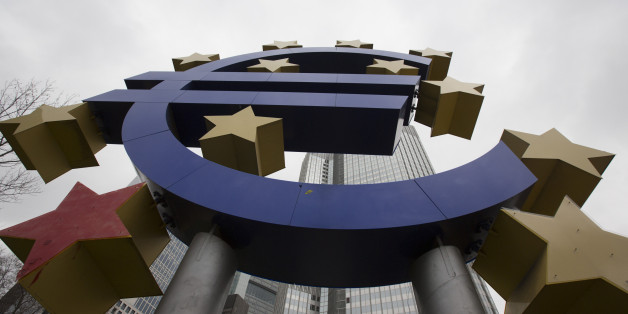 A euro sign sculpture stands in front of the former European Central Bank (ECB) headquarters in Frankfurt, Germany, on Wednesday, Jan. 28, 2015. Economic sentiment in the euro area rose for the first time in three months after the European Central Bank committed to spend at least 1.1 trillion ($1.3 trillion) euros on fueling growth and inflation. Photographer: Martin Leissl/Bloomberg via Getty Images