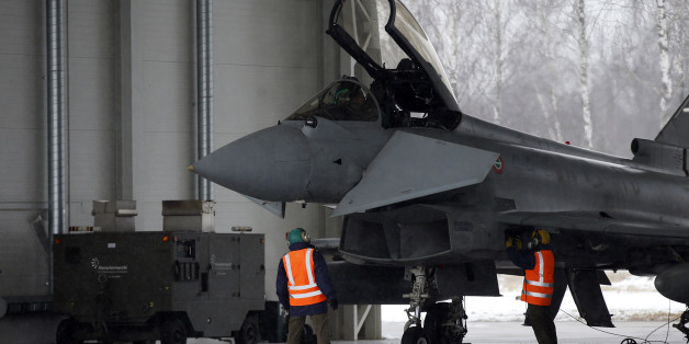 Italy's Eurofighter Typhoon jet fighter prepares for take off during NATO's Baltic Air  Policing Mission at the Siauliai airbase some  240 kms (150 miles) east of the capital  Vilnius, Lithuania, Thursday, Jan. 29, 2015. (AP Photo/Mindaugas Kulbis)
