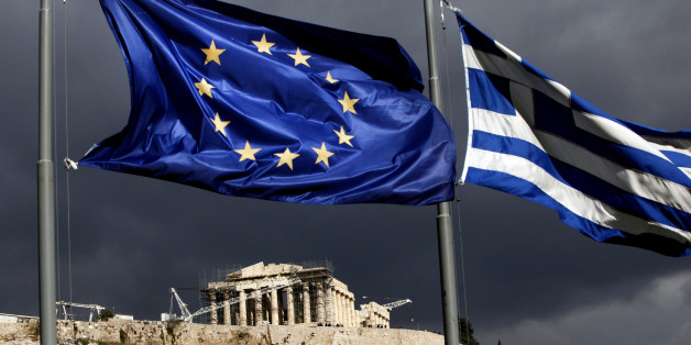 A European Union (EU) flag, left, and Greek national flag fly near the Parthenon temple on Acropolis hill in Athens, Greece, on Monday, Oct. 31, 2011. Europe's plan to solve the region's debt crisis made credit-default swaps covering Greece 'ineffective,' Moody's Investors Service said. Photographer: Angelos Tzortzinis/Bloomberg via Getty Images