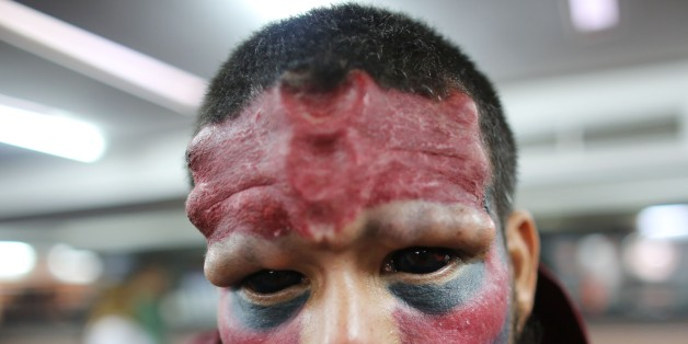A Venezuelan man known as Red Skull poses for a portrait during the annual Venezuela Tattoo International Expo in Caracas, Venezuela, Thursday, Jan. 29, 2015. Tattoo artists from around the world are gathering for the four-day event that also includes under the skin implants and body piercing. (AP Photo/Ariana Cubillos)