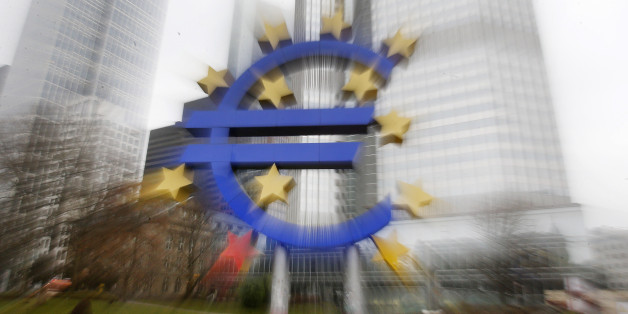 In this zoomed picture the Euro sculpture stands in front of the old European Central Bank in Frankfurt, Germany, Monday, Jan. 26, 2015.  The euro wobbled Monday after Greece's anti-austerity opposition party won a big victory in national elections, renewing fears the European common currency bloc could unravel.(AP Photo/Michael Probst)